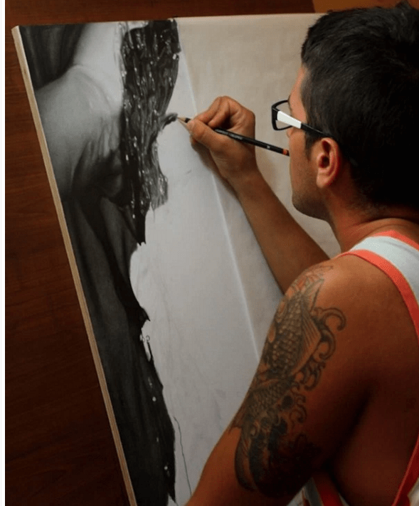 man drawing with pencil