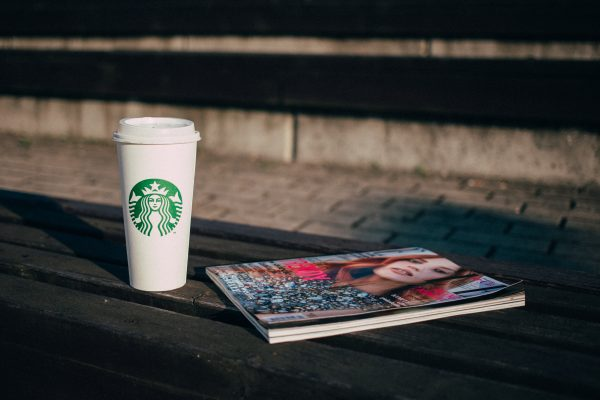 coffee_and_a_magazine_on_a_bench