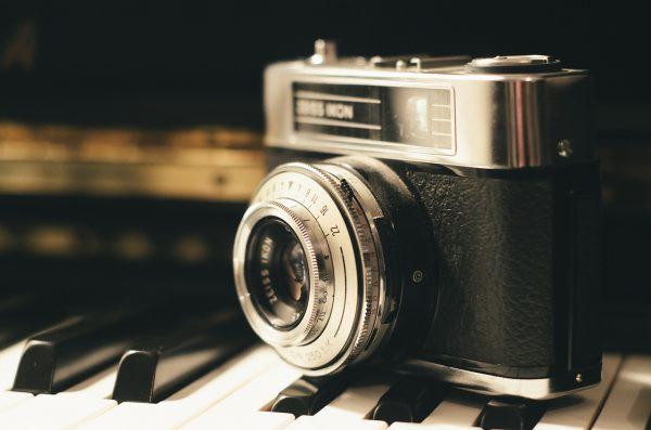 camera on piano keys