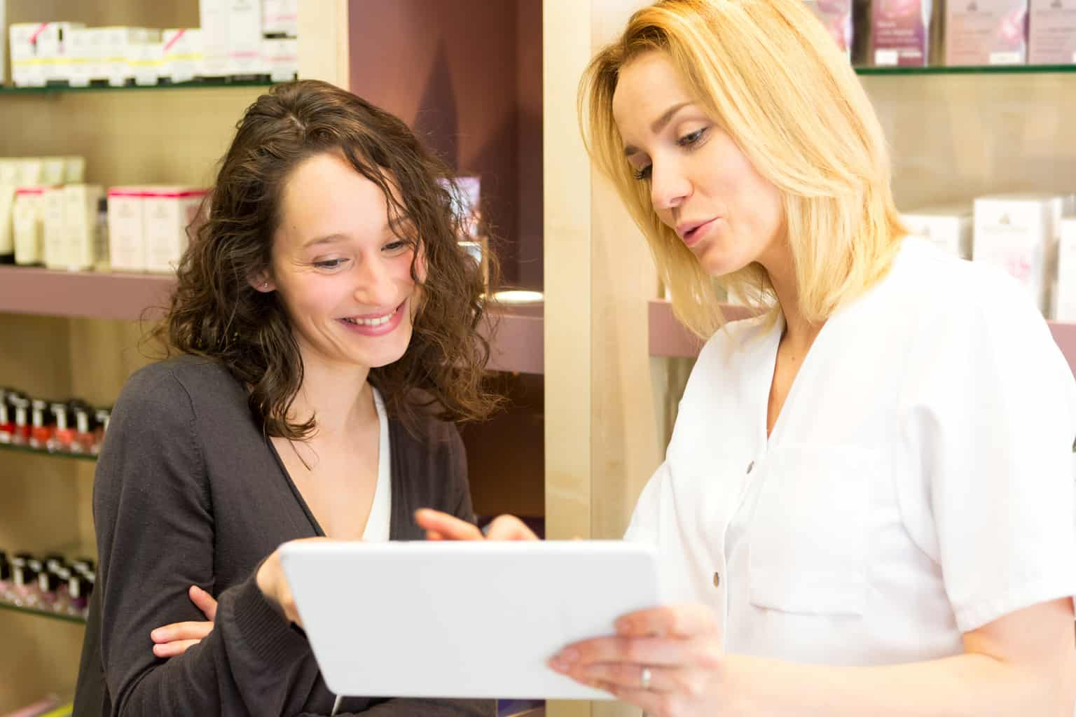 Young attractive beautician woman presenting product to customer