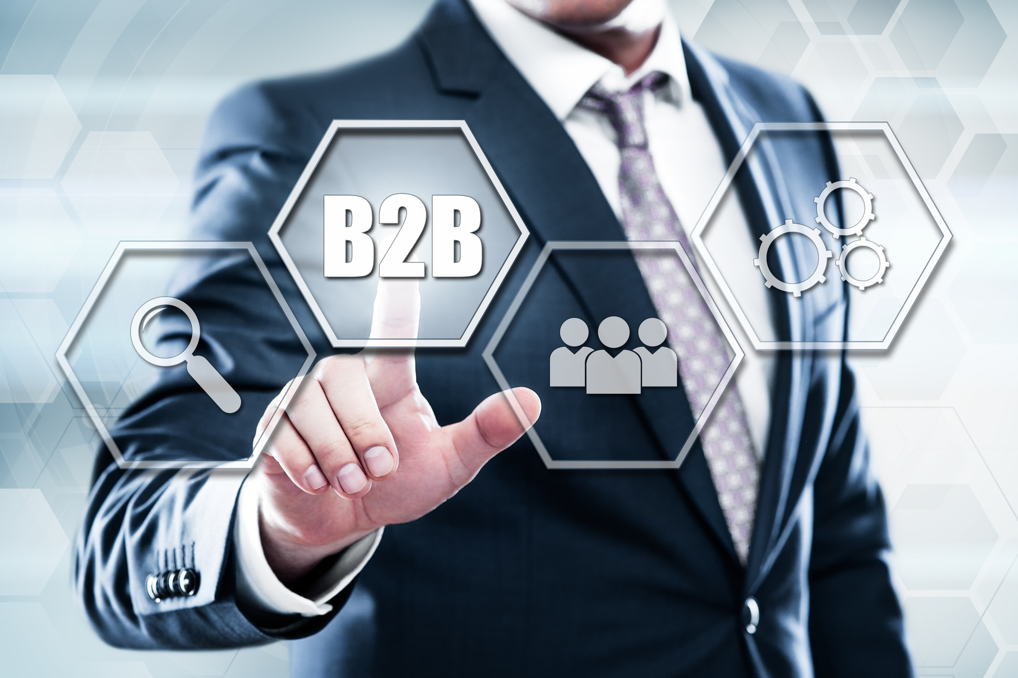 Business, technology, internet concept on hexagons and transparent honeycomb background. Businessman pressing button on touch screen interface and select b2b